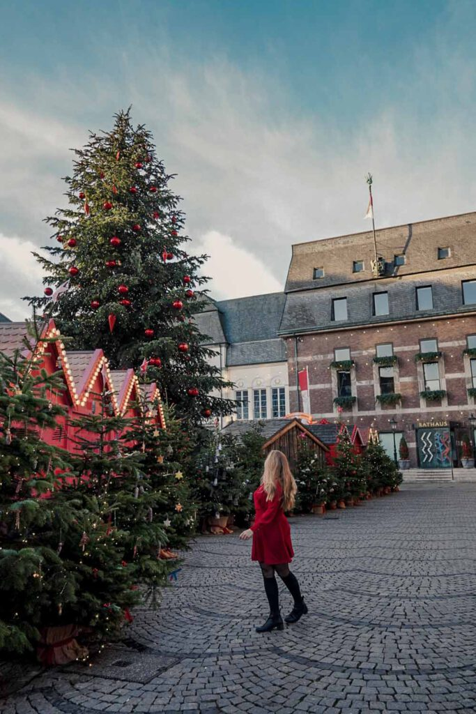 Girl in front of giant christmas tree