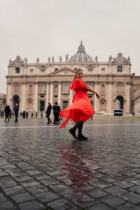 La Vie En Marine twirling in front of the St. Peters Basilica on her Photography Tour through Rome