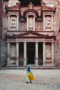 girl standing in front of the treasury petra