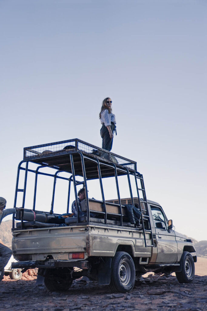 Girl standing on Top of a Jeep in Wadi Rum