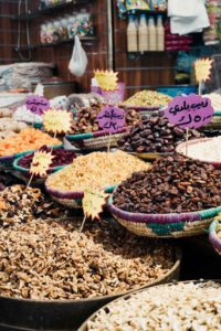 Bowls of grains and nuts being piled up in the Souk of Amman, Jordan