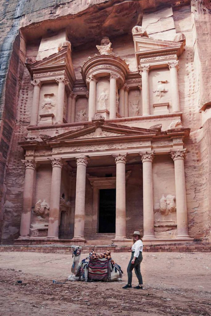 Camel and girl in front of the Treasury of Petra