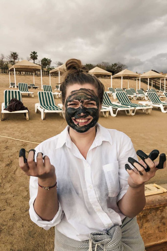 girl with mud from the dead sea on her face