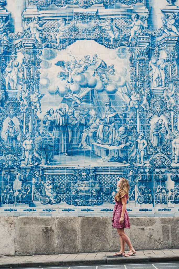 Girl in front of the blue church in porto