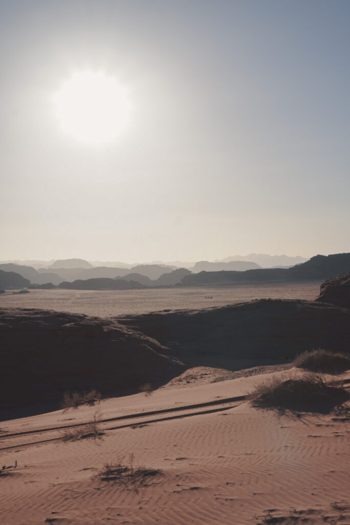 Watching the sunset in wadi rum desert
